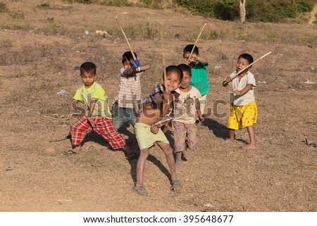 MRAUK-U, MYANMAR - JANUARY 26, 2016:  Unidentified poor but healthy children group portrait outdoors - stock photo