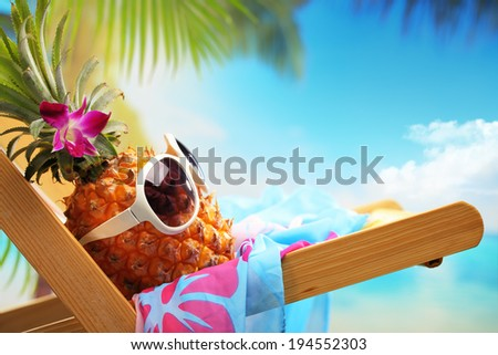 Ms pineapple on beach chair - stock photo