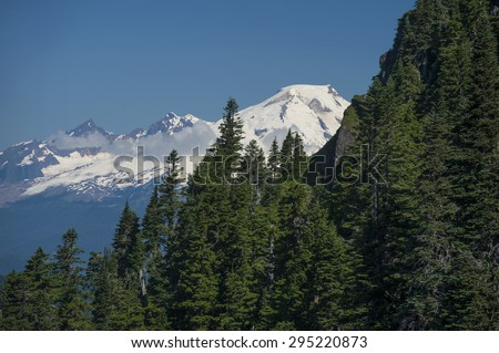 Mt. Baker from Sauk Mountain. The snow capped Mt. Baker in the North Cascade mountains as seen from the Sauk Mountain trail in western Washington State. - stock photo