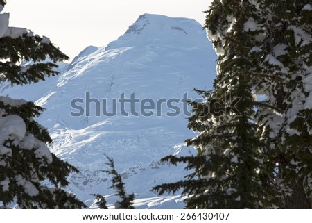 Mt Baker is one of the most picturesque landmarks in the Pacific Northwest and the Cascade Mountains. In this photo you can observe glaciers receding and large glacial ice and snow formations - stock photo