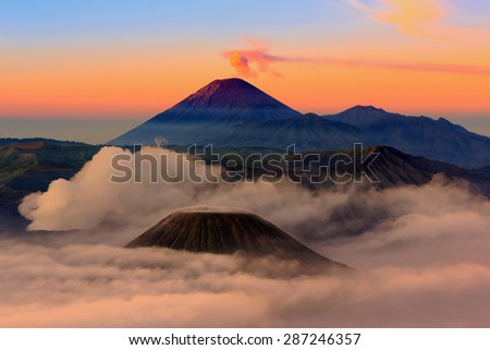 Mt.Bromo,Mt.Semeru,Mt.Batok covered with fog and sulfur gas.These are some of the active volcanoes In East Java,Indonesia - stock photo