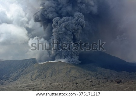 Mt. Bromo volcano  erupts in Java, Indonesia - stock photo