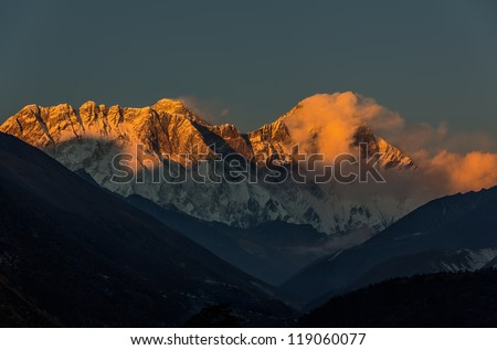 Mt. Everest (8848 m) and Lhotse (8511 m) in the last light of the Sun (view from Tengboche monastery) - Nepal, Himalayas - stock photo