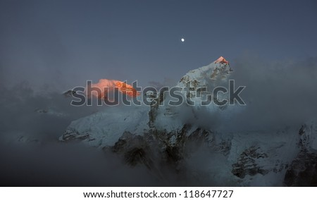 Mt. Everest (8848 m)  in the last light of the Sun (view from Kala Patthar) - Nepal, Himalayas - stock photo
