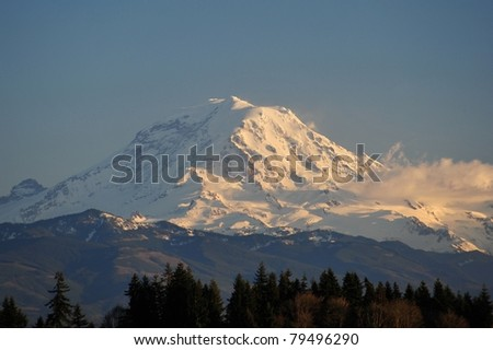 Mt. Rainier Sunset beyond Lake Tappa - stock photo