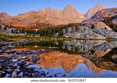 Mt. Ritter and Banner Peak Reflected in an Ediza Lake.  The Ansel Adams Wilderness, Mammoth, California - stock photo
