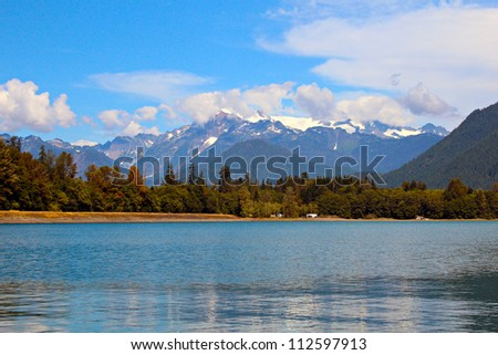 Mt. Shuksan as viewed from accross Baker Lake which is located in Whatcom County in the North Cascades National Park, Washington state. - stock photo