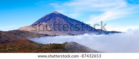 Mt Teide Volcano in Tenerife Panorama with blue sky and clouds - stock photo