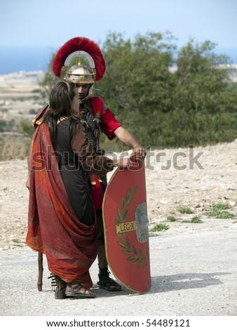 MTARFA, MALTA - MAY 23 - Roman Centurion courts a lady on May 23, 2010 in Mtarfa Malta - stock photo