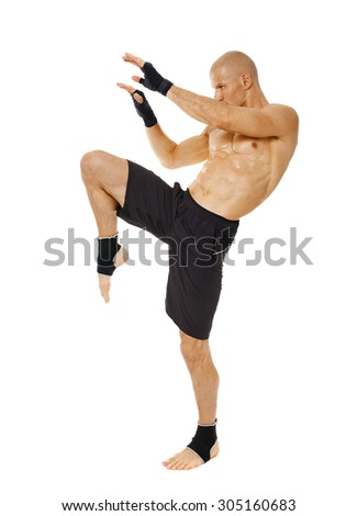 Muay thai fighter delivering a knee blow, isolated on white background - stock photo