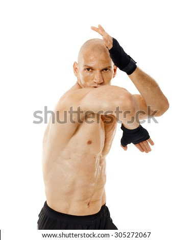 Muay thai fighter delivering an elbow hit isolated on white background - stock photo