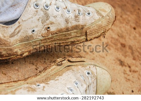 Mud on dirty shoes - stock photo