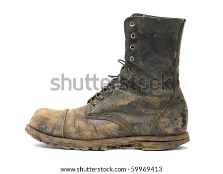 Muddy steelcap boots isolated on white - stock photo