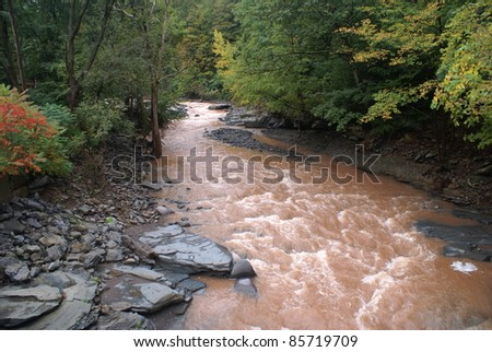 Muddy waters after flooding - stock photo
