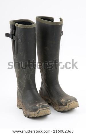 Muddy wellies - stock photo