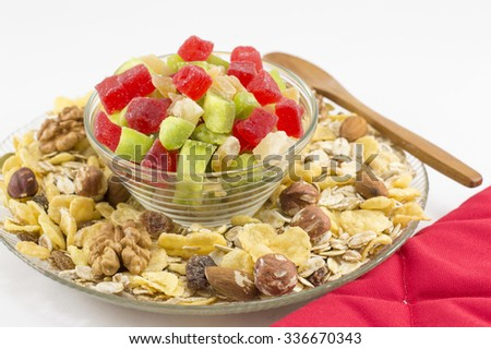 Muesli and dried fruit served in glass bowls - stock photo