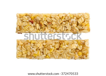 Muesli bar with apple, nuts and sugar isolated on white - stock photo