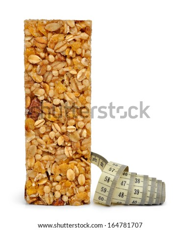 Muesli Bar with measuring tape  isolated on white background  - stock photo