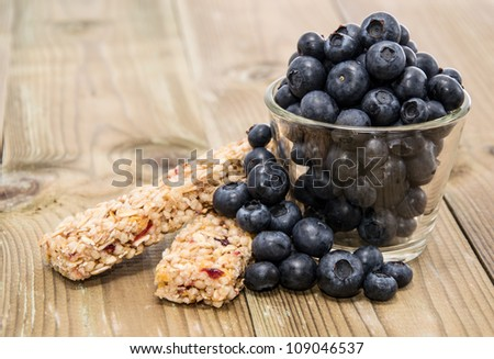 Muesli Bars with Blueberries in a glass on a wooden table - stock photo