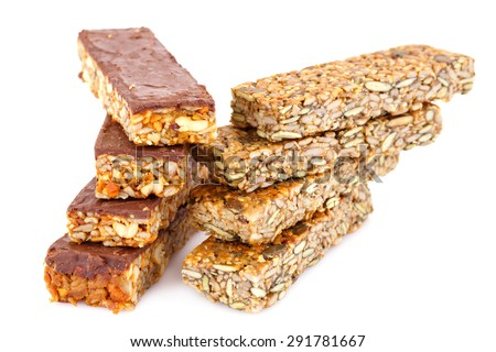 Muesli bars with different nuts and seeds isolated on white background. - stock photo
