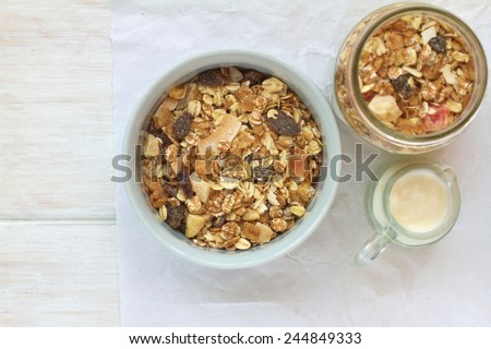 Muesli breakfast on a vintage wooden background  - stock photo