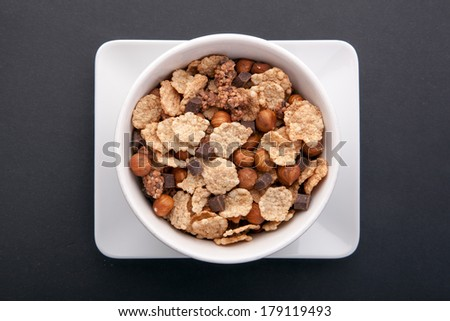 Muesli breakfast on black background - stock photo