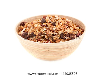 Muesli in the bowl isolated on white background. - stock photo