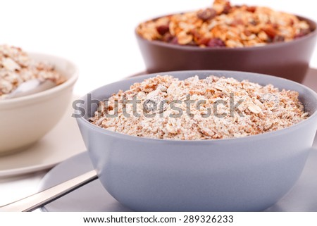 Muesli in the bowls on white background. - stock photo