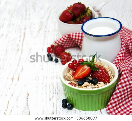 Muesli with berries on a old wooden background - stock photo