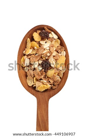 Muesli with dried fruits on wooden spoon. Isolated on white background. Directly Above. - stock photo