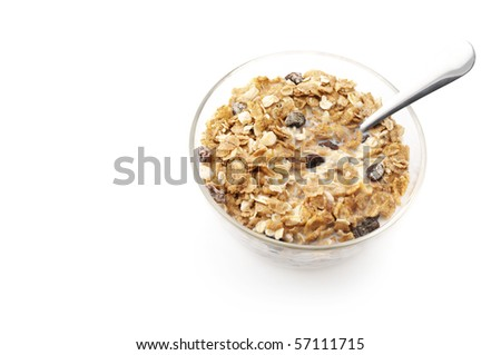 Muesli with milk in glass bowl isolated on white background. - stock photo