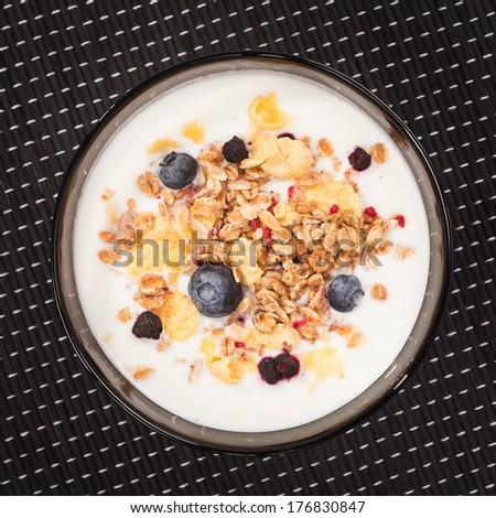 Muesli with yogurt and fresh blueberries. Top view - stock photo