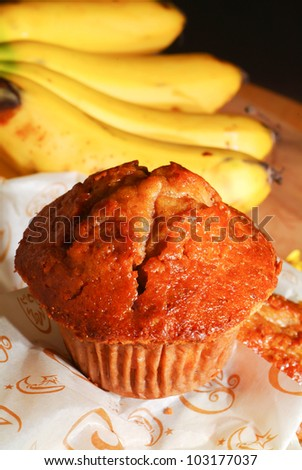 muffins and ingredients in the background. - stock photo