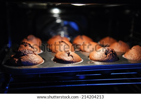 muffins on a baking tray in the oven close up - stock photo
