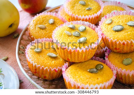 Muffins with apples and pumpkin seeds. Selective focus - stock photo