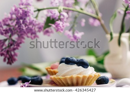 muffins with blueberries on a purple background - stock photo