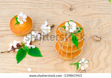 Muffins with filling on the wooden table. Selective focus - stock photo