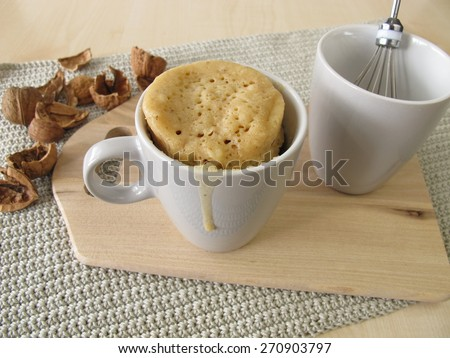 Mug cake with walnuts from microwave  - stock photo