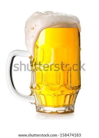 Mug fresh beer with cap of foam isolated on white background - stock photo