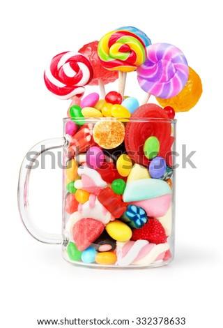 mug glass full of candies isolated on white - stock photo