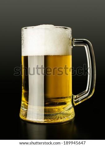 mug of beer isolated on black - stock photo