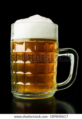 mug of beer on a black background - stock photo