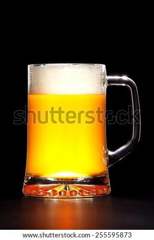 mug of beer on a black background - stock photo