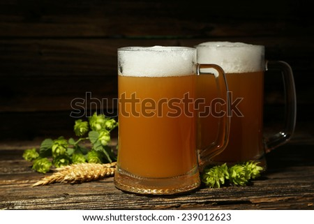 Mug of beer on a brown wooden background - stock photo