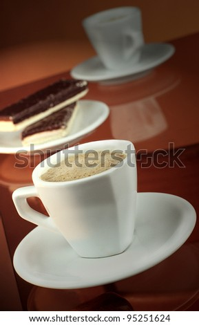 Mug of coffee with wafers - stock photo