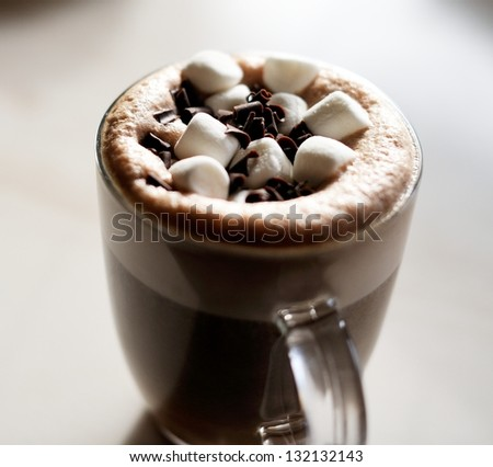Mug of hot chocolate with marshmallows on table - stock photo