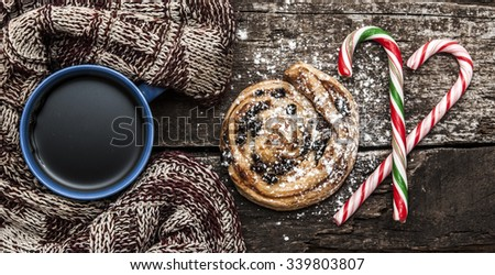 Mug of hot tea or coffee with scarf. Christmas decorations. - stock photo