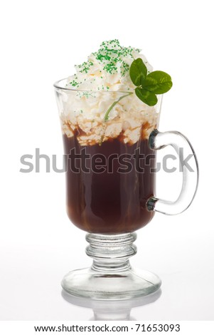 Mug of Irish Coffee with green sprinkles and clover leaf for St Patrick's Day - stock photo