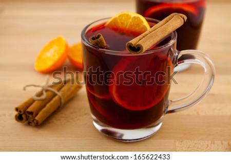 mug of mulled wine with cinnamon and orange - stock photo