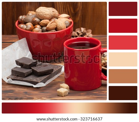Mug Of Tea Or Coffee. Sweets And Spices. Bowl Of Nuts. Christmas Decorations. Wooden Background. Palette With Complimentary Colour Swatches. - stock photo